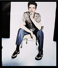 Bowie in a seated pose