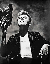 Bowie holding up a small sculpture